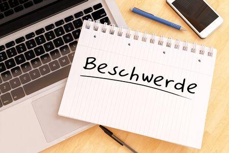 Beschwerde german word for appeal or complaint in a notebook on a desk 写真素材