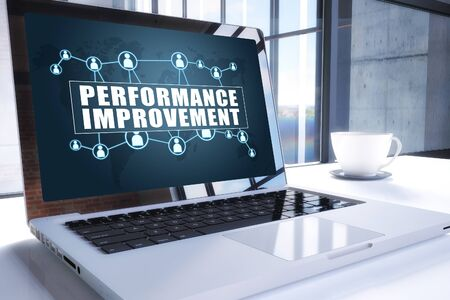 Performance Improvement text on modern laptop screen in office environment. 写真素材