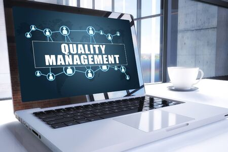 Quality Management text on modern laptop screen in office environment. 写真素材