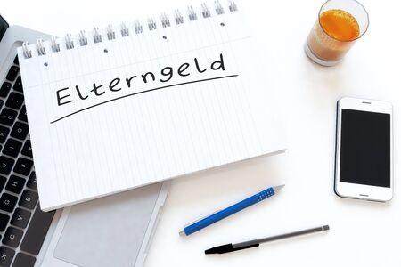 Elterngeld german word in a notebook on a desk for parental allowance or parental benefits