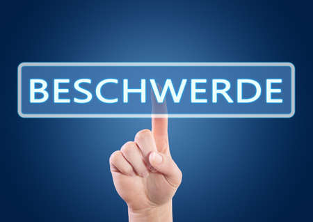 Complaint - german word for appeal or complaint - Hand button on interface with blue background.