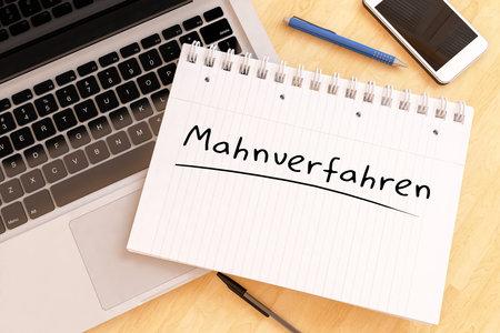 Mahnverfahren - german word for dunning procedure - handwritten text in a notebook on a desk - 3d render illustration.
