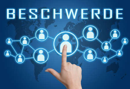 Complaint - german word for appeal or complaint - text concept with hand pressing social icons on blue world map background.