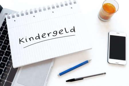 Kindergeld - german word for child benefit or allowance - handwritten text in a notebook on a desk - 3d render illustration.
