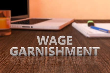 Wage Garnishment - letters on wooden desk with laptop computer and a notebook. 3d render illustration. Standard-Bild