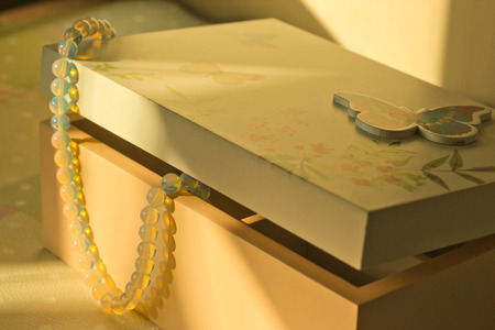 dearness: Box with jewelry in pastel tone and sunlights