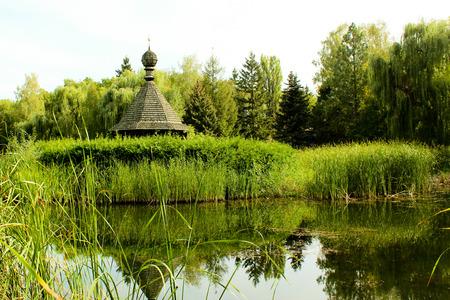 frail: Ukrainian retro church in the pond Stock Photo