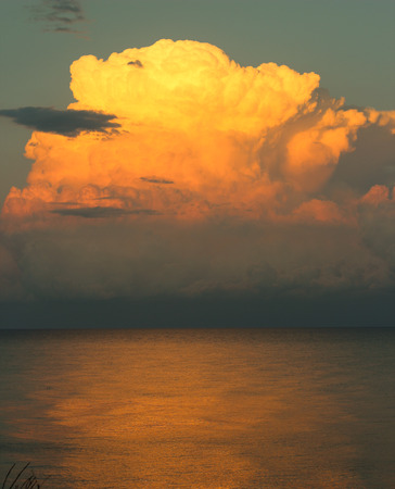 windstorm: Storm cloud over the evening sea