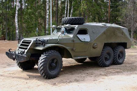The russian 3 axes armored car at the sand. Stock Photo