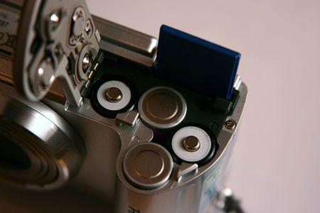 AA battaries inside digital photo camera.