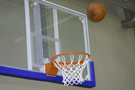 Basketball basket with ball close up