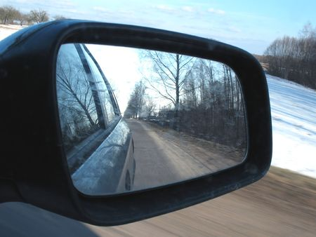Side mirror view from inside car.