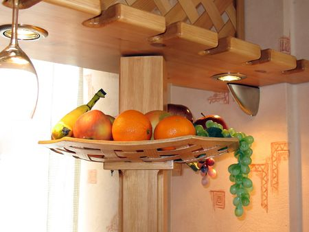 Kitchen wooden shelf with fruits