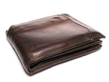 An old brown leather wallet isolated on white.