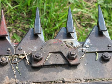 An extreme close -up of mowing machine blades.