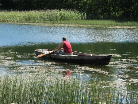 The young male fisherman on the boat.