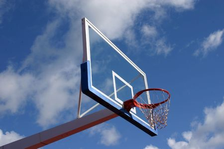 Basketball basket on cloudy sky background.