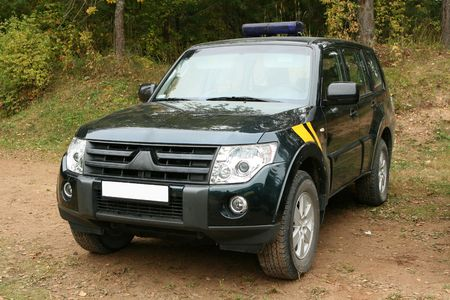 Special force`s patrol jeep in forest.