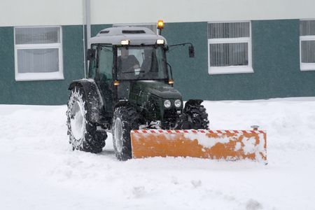Tractor removing snow.