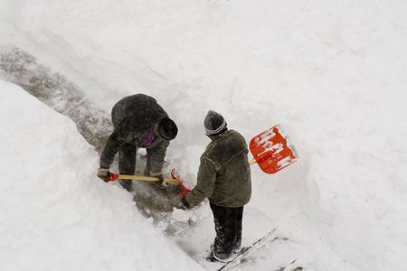 2 worker cleaning deep snow. Stock Photo