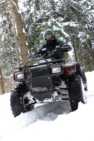 Special force man on quadbike.