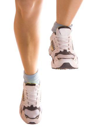Running girl`s legs isolated on white. Stock Photo