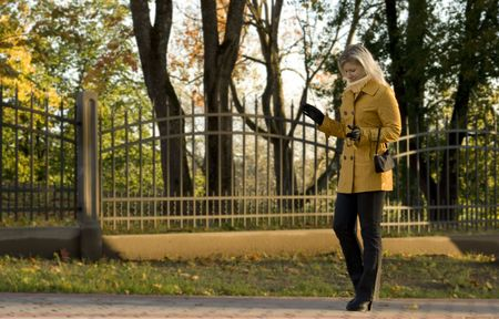 Young woman walking at autumn park. photo