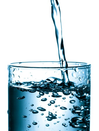 Water splash in a glass. Isolated on white.