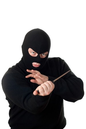 Terrorist in black mask with knife. Isolated on white. Stock Photo