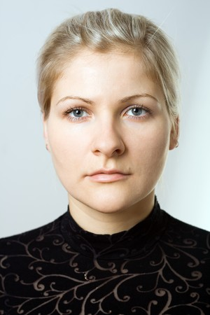 Serious young blonde woman portrait.