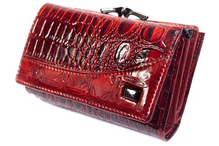 Red shiny purse isolated on white.