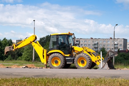 Working excavator on a roadside. photo