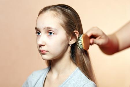 Teen model combing. photo