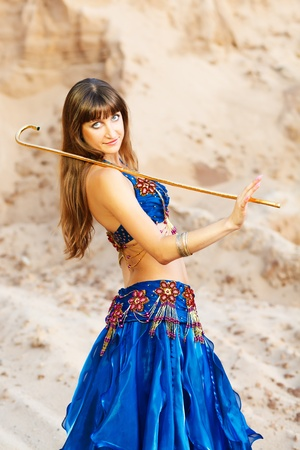 bellydance: East belly dancer in blue lingerie with gold can. Stock Photo