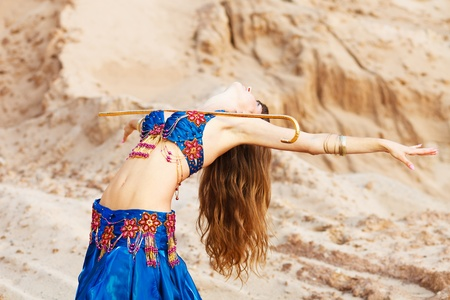 East belly dancer in blue lingerie. photo
