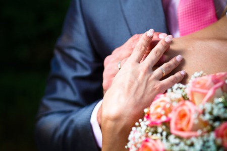 Hands with wedding ring. photo