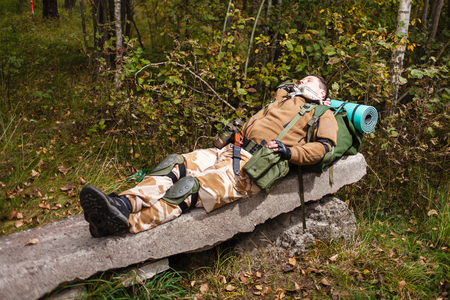 people relaxing: Soldier relaxing on reinforced concrete slab.