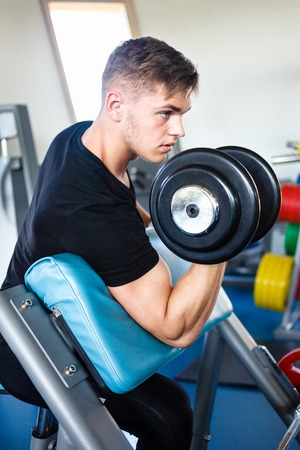 Biceps workout on a smit` h bench.