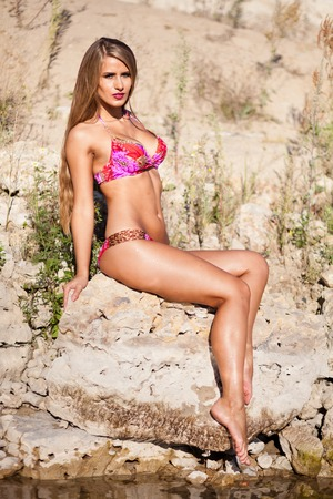 Long hair girl in bikini on river. Stock Photo