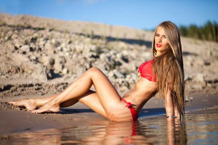 Girl in red bikini on a beach.