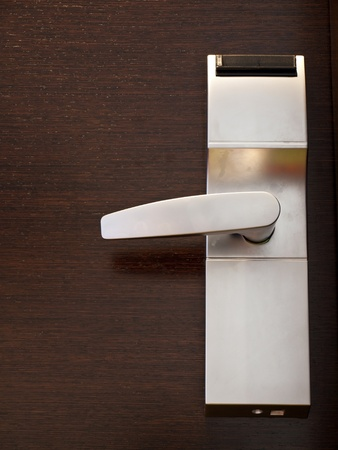 Electronic lock on wooden door  Stock Photo - 12879291