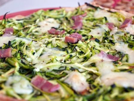 Colorful pizza with zucchini and mozzarella close up