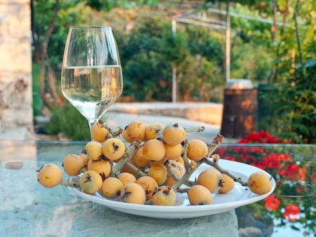 Glass of white wine with traditional mediterranean fruit