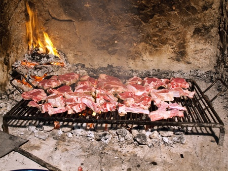 Delicious raw red meat on grill