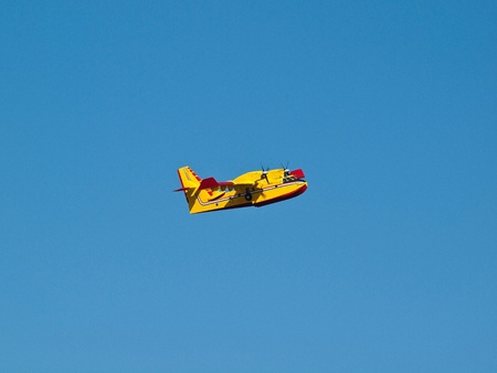 fire fighter: Fire fighter airplane flying on blue sky