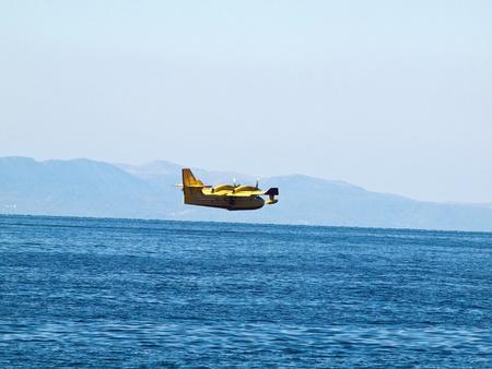 hydroplane: Hydroplane flying over blue sea