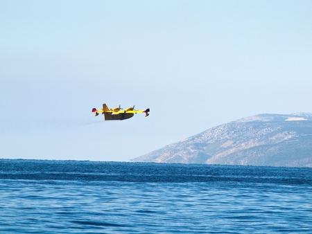 Airplane flying near the blue sea