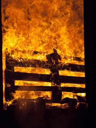 Burning fire in interior of house Stock Photo
