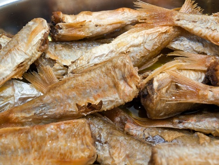 Delicious fried fish with olive oil