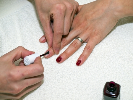 Nails painting on white towel in cosmetic salon Stock Photo - 13866920